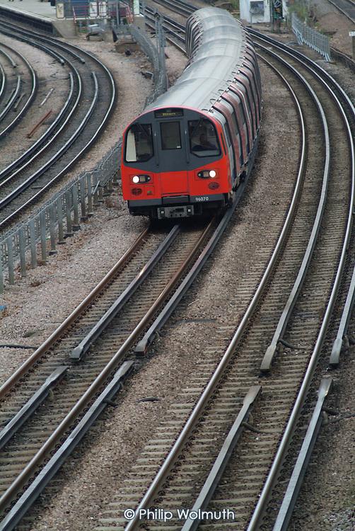 London underground train leaves Kilburn station on the Jubilee line.