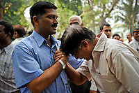 A mourner breaks down during the funeral of Joint Commissioner of Police, Mr Hemant karkare's funeral in Mumbai on the 29th of November 2008, Mumbai, India.