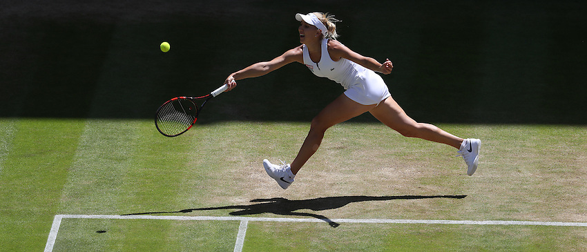 Elena Vesnina of Russia in action during her defeat by Serena Williams of USA in their Ladies' Singles Semi-Final match today<br /> <br /> Photographer Stephen White/CameraSport<br /> <br /> Tennis - Wimbledon Lawn Tennis Championships - Day 10 - Thursday 7th July 2016 -  All England Lawn Tennis and Croquet Club - Wimbledon - London - England<br /> <br /> World Copyright &copy; 2016 CameraSport. All rights reserved. 43 Linden Ave. Countesthorpe. Leicester. England. LE8 5PG - Tel: +44 (0) 116 277 4147 - admin@camerasport.com - www.camerasport.com
