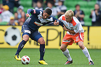 MELBOURNE, AUSTRALIA - SEPTEMBER 12, 2010: Carlos Hernandez from the Victory and Mitch Nichols from the Roar compete for the ball in Round 6 of the 2010 A-League between the Melbourne Victory and Brisbane Roar at AAMI Park on September 12, 2010 in Melbourne, Australia. (Photo by Sydney Low / Asterisk Images)