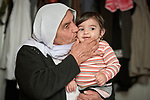 Adlane Saido kisses her 9-months old grandchild Zylan in a camp for internally displaced Yazidis at Dawodiya in Iraq's Kurdistan region. More than 600 Yazidi families living in the camp escaped from their communities in the Sinjar region during the attempted genocide by the Islamic State group. Although ISIS was militarily defeated in 2017, camp residents say it's still not safe for them to return home, nor do they have sufficient resources to rebuild their homes.<br /> <br /> The Lutheran World Federation, a member of the ACT Alliance, provides water, sanitation, garbage collection, and psycho-social support for the families in the camp.