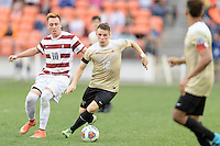 Houston, TX - Friday December 11, 2016: Brad Dunwell (12) of the Wake Forest Demon Deacons brings the ball up the field against the Stanford Cardinal at the NCAA Men's Soccer Finals at BBVA Compass Stadium in Houston Texas.