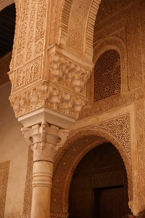 """The Alhambra in Granada was the last and greatest Moorish palace- in this case, a plaster """"stalactite"""" ornamental design feature adorned with graphic design."""
