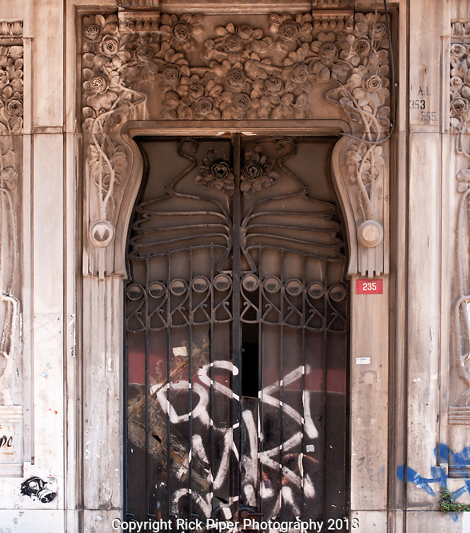 Once Was Splendid - Graffiti on the ornate doorway of the art nouveau style Botter apartment building, 235 Istiklal Caddesi, Beyoglu, Istanbul, Turkey