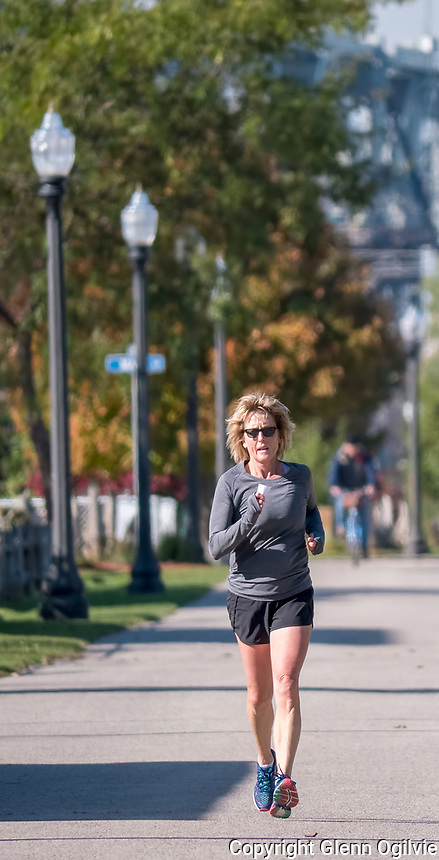 "Laurie Delavigne, of Sarnia, casual runner.<br /> Works out at Ironworks gym, but on nice days likes to run outdoors to get her cardio up. <br /> ""I love the fall,"" she said while taking a rest from logging along the river front."