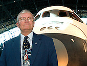 "Former astronaut Fred Haise poses in front of the Space Shuttle Enterprise during the first anniversary celebration of the Smithsonian National Air and Space Museum Steven F. Udvar-Hazy Center in Chantilly, Virginia on December 11, 2004.  From April 1973 to January 1976, he was technical assistant to the Manager of the Space Shuttle Orbiter Project. He was commander of one of the two 2-man crews who piloted space shuttle approach and landing test (ALT) flights during the period June through October 1977. This series of critical orbiter flight tests involved initially Boeing 747/orbiter captive-active flights, followed by air-launched, unpowered glide, approach, and landing tests (free flights). There were 3 captive mated tests with the orbiter ""Enterprise"" carried atop the Boeing 747 carrier aircraft, allowing inflight low-altitude and low-speed test and checkout of flight control systems and orbiter controls, and 5 free flights which permitted extensive evaluations of the orbiter's subsonic flying qualities and performance characteristics during separation, up and away flight, flare, landing, and rollout--providing valuable real-time data duplicating the last few minutes of an operational shuttle mission.  The shuttle Enterprise is the centerpiece of the James S. McDonnell Space Hanger at the center.  Haise was the lunar module pilot on Apollo 13 (April 11-17, 1970) and has logged 142 hours and 54 minutes in space.  This mission was the inspiration for the hit 1995 movie ""Apollo 13"".  Bill Paxton played the role of Mr. Haise in the movie..Credit: Ron Sachs / CNP.(RESTRICTION: NO New York or New Jersey Newspapers or newspapers within a 75 mile radius of New York City)"