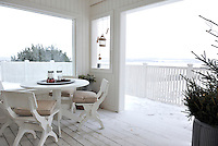 An integrated veranda at the back of the house is a nice place to sit in both summer and winter, with views out across the Oyeren countryside