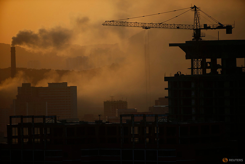 People work atop a building under construction as sun sets in Pyongyang, North Korea April 12, 2017.    REUTERS/Damir Sagolj