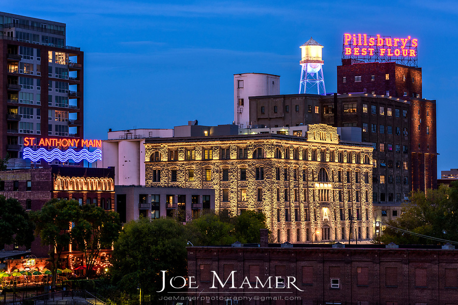 St. Anthony Main area of Minneapolis with the Pillsbury A Mill building and Pillsbury's Best Flour sign  lighted.