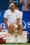 SHANGHAI, CHINA - OCTOBER 17:  Feliciano Lopez of Spain examines his foot before retiring against his compatriot Rafal Nadal on their semi final match during day seven of 2009 Shanghai ATP Masters 1000 at Qi Zhong Tennis Centre on October 17, 2009 in Shanghai, China. Photo by Victor Fraile / The Power of Sport Images