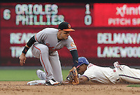 PHILADELPHIA - JUNE 18: Ryan Flaherty #3 of the Baltimore Orioles attempts to tag out Ben Revere #2 of the Philadelphia Phillies as he steals second base in the sixth inning during a game at Citizens Bank Park on June 18, 2015 in Philadelphia, Pennsylvania. The Phillies won 2-1. (Photo by Hunter Martin/Getty Images) *** Local Caption *** Ryan Flaherty;Ben Revere
