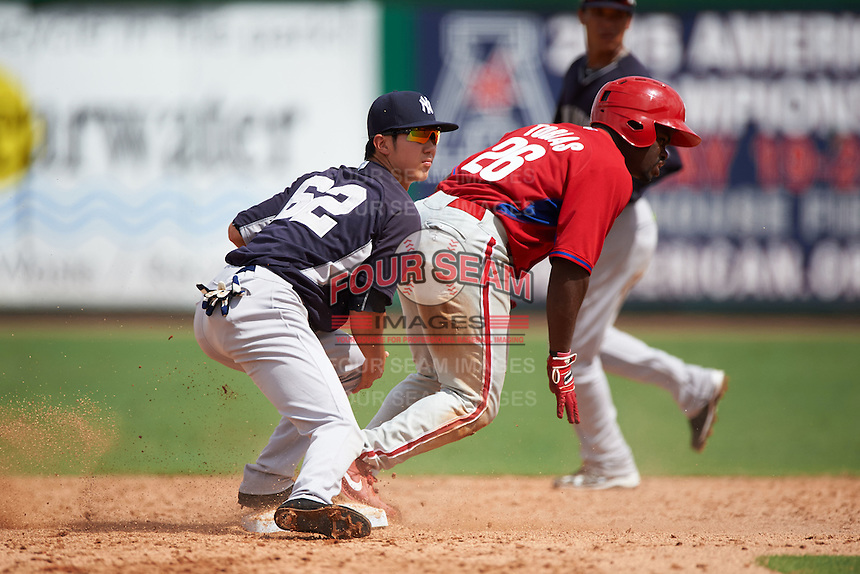 New York Yankees Hoy Jun Park (62) looks to the umpire for the call as Josh Tobias (26) slides in during an instructional league game against the Philadelphia Phillies on September 29, 2015 at Brighthouse Field in Clearwater, Florida.  (Mike Janes/Four Seam Images)