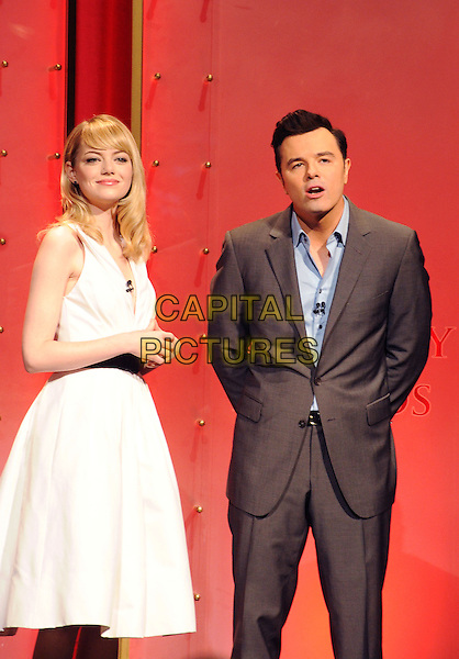 Emma Stone, Seth MacFarlane.at The 85th Academy Awards Nominations Announcement held at the Samuel Goldwyn Theater at AMPAS in Beverly Hills, California, USA, .January 10th, 2013. .oscar oscars noms half length white shirt  belt black sleeveless low cut v-neck collar cream fifties retro dress blue shirt grey gray suit .CAP/ROT/TM.©Tony Michaels/Roth Stock/Capital Pictures
