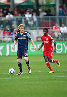 22 May 2010: New England Revolution defender Pat Phelan #28 and Toronto FC forward Fuad Ibrahim #7 in action during a game between the New England Revolution and Toronto FC at BMO Field in Toronto..Toronto FC won 1-0.....