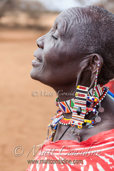 Masai woman in traditional beadwork jewellery singing a welcome in Kenya, Africa (photo by Travel Photographer Matt Considine)