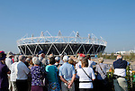Tourists viewing the 2012 Olympic Stadium, Stratford, London, England
