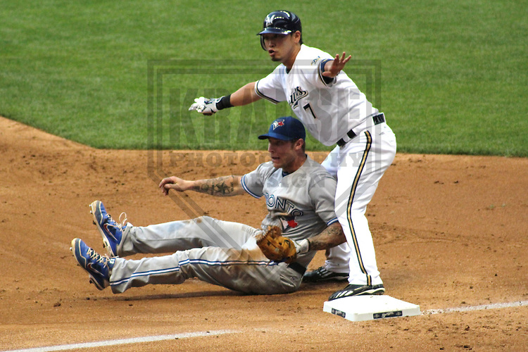 MILWAUKEE - June 2012: Brett Lawrie (13) of the Toronto Blue Jays tags out Norichika Aoki (7) of the Milwaukee Brewers during a game on June 18, 2012 at Miller Park in Milwaukee, Wisconsin. (Photo by Brad Krause). .