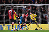 27th January 2020; Vitality Stadium, Bournemouth, Dorset, England; English FA Cup Football, Bournemouth Athletic versus Arsenal; the header from Dan Gosling of Bournemouth goes over the crossbar as Bellerín of Arsenal closes in