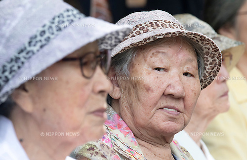 Kil Won-ok and Kim Bok-dong, Aug 29, 2016 : Kil Won-ok (C) and Kim Bok-dong (L), who said that they were forced to become a sex slave by Japanese army during World War II, attend an opening ceremony for a park commemorating the victims of Japan's sexual enslavement during Japan's occupation of the Korean Peninsula (1910-45), on Mount Nam in Seoul, South Korea. The Seoul Metropolitan Government and a committee which is charge of building the memorial park held the ceremony on Monday, which  marks the 106th anniversary of the colonization. The place of the memorial park is the former residence of Japan's colonial-era resident-general, where the annexation treaty between Korea and Japan was signed on August 22, 1910. The treaty went into effect one week later. (Photo by Lee Jae-Won/AFLO) (SOUTH KOREA)