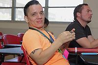 OrigamiUSA 2016 Convention at St. John's University, Queens, New York, USA. Creasers in Kade Chan's Capricorn class. Diego Fernandez Becerra Ramirez enjoys a fold.