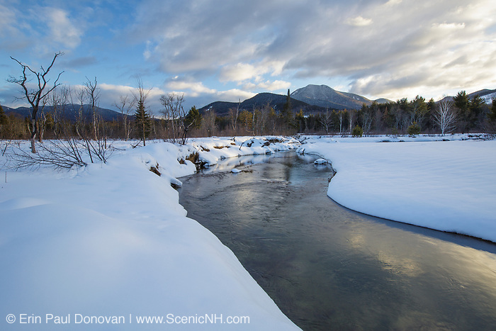 Swift River during the winter months in Albany, New Hampshire. This river travels along side of the Kancamagus Scenic Byway, which is one of New England's scenic byways. Mount Passaconaway is off in the distance