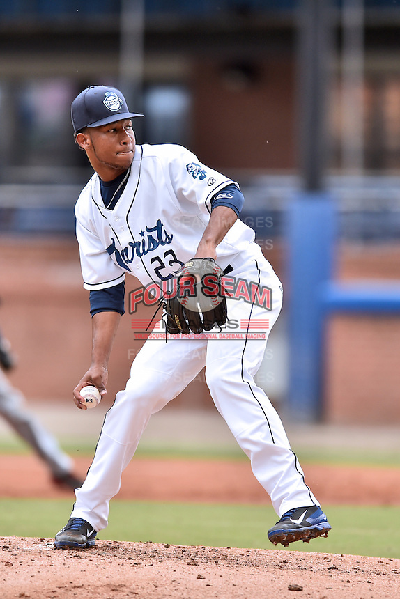 Asheville Tourists starting pitcher Alexander Guillen (23) delivers a pitch during a game against the Hagerstown Suns at McCormick Field on June 6, 2016 in Asheville, North Carolina. The Tourists defeated the Suns 12-10. (Tony Farlow/Four Seam Images)