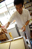 Tadashi Kozuka demonstrates making yuba, Nikko, Tochigi pref, Japan, June 26, 2010.