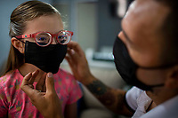 HERMOSILLO, MEXICO - MAY 08: Oscar Rai Villa de los Reyes footballer of the Cimarrones De Sonora helps his daughter Abril Maribel to put on a Face Mask as a preventive measure of virus contagion despite staying at home on May 8, 2020 in Hermosillo, Mexico. Due to the Coronavirus crisis the Liga MX has announced the cancellation of the Ascenso MX 2019-2020 season and to temporarily suspend promotions and relegations for the next six seasons. (Photo by Luis Gutierrez/Norte Photo/Getty Images)