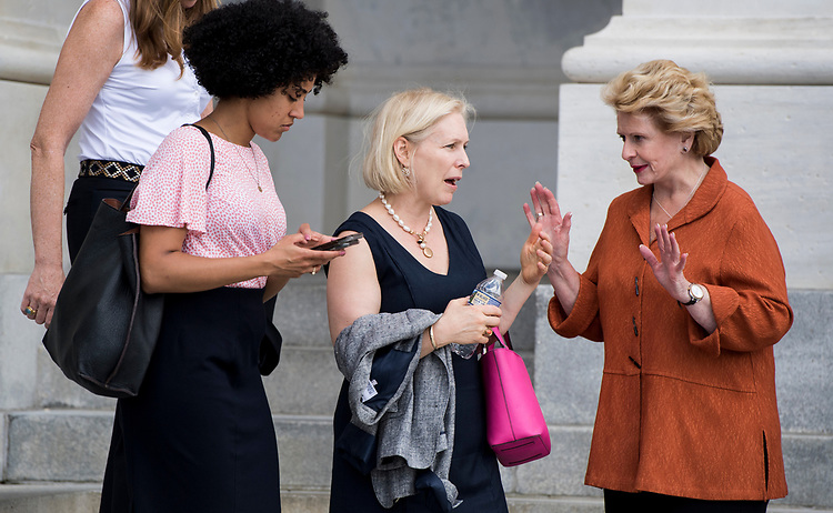 UNITED STATES - AUGUST 1: Sen. Kirsten Gillibrand, D-N.Y., center, and Sen. Debbie Stabenow, D-Mich., right,  talk outside of the Capitol after the last vote of the week in the Senate on Wednesday, Aug. 1, 2018. (Photo By Bill Clark/CQ Roll Call)