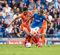 Portsmouth's Christian Burgess (right) is tackled by Shrewsbury Town's Aaron Amadi-Holloway (left) <br /> <br /> Photographer David Horton/CameraSport<br /> <br /> The EFL Sky Bet League One - Portsmouth v Shrewsbury Town - Saturday September 8th 2018 - Fratton Park - Portsmouth<br /> <br /> World Copyright &copy; 2018 CameraSport. All rights reserved. 43 Linden Ave. Countesthorpe. Leicester. England. LE8 5PG - Tel: +44 (0) 116 277 4147 - admin@camerasport.com - www.camerasport.com