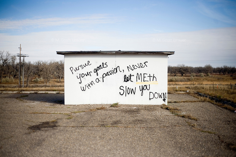 A small building is covered with anti-meth messages in Fort Belknap Agency, Montana, USA. Many cities and towns in Montana have put up anti-meth and anti-drug signs in recent years.