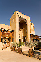 Dubai.  Grand Arab style entry to Madinat Jumeirah, shopping mall and souk, with wind tower..