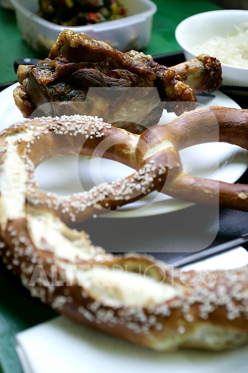 Tipical food, pretzl (breze) and pork knee roasted in Munich, Germany, July 31, 2008. (ALTERPHOTOS/Alvaro Hernandez)