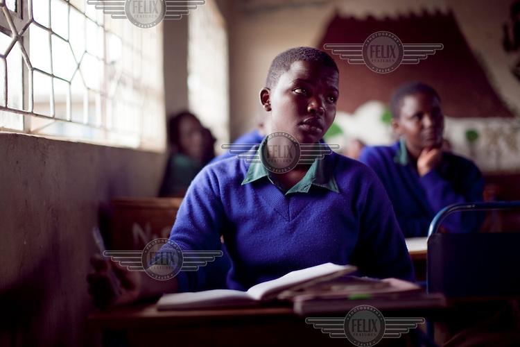 Survivor of FGM (female genital mutilation) Frida Alex, 18, studies in class at the Noonkondin Secondary School run by Gemma Enolengila and Lesikar Olengila.