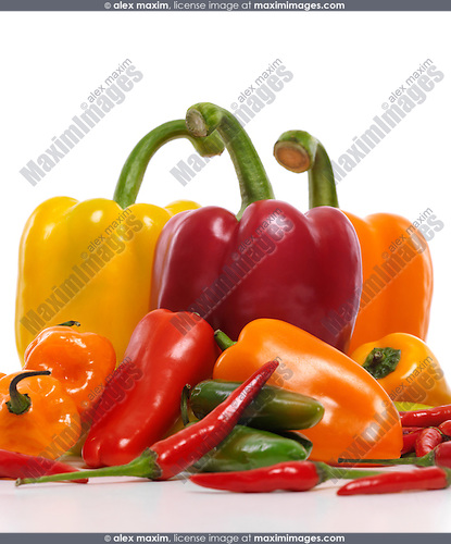 Variety of colorful sweet and hot peppers, red, yellow, orange sweet peppers, Jalapeno, Cubanelle, Thai peppers, Scotch Bonnet pepper, mini sweet peppers. Food still life isolated on white background.