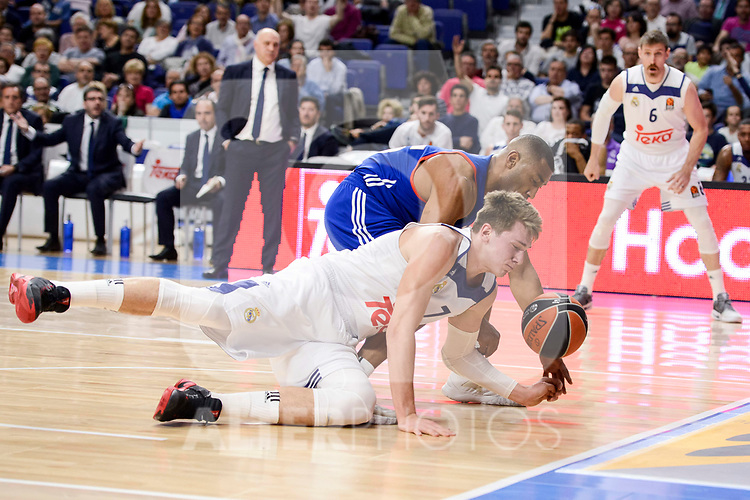 Real Madrid's Luka Doncic and Anadolu Efes's Jayson Granger during Turkish Airlines Euroleague match between Real Madrid and Anadolu Efes at Wizink Center in Madrid, April 07, 2017. Spain.<br /> (ALTERPHOTOS/BorjaB.Hojas)