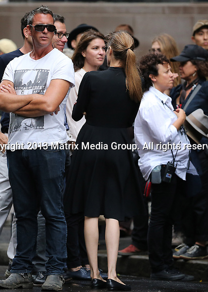 21 NOVEMBER 2013 SYDNEY AUSTRALIA<br /> <br /> NON EXCLUSIVE <br /> <br /> Angelina Jolie pictured on set of 'Unbroken' giving direction during takes. Angelina was dressed in a matronly but elegant black blouse and skirt for the first day of filming in Sydney CBD. <br /> <br /> *No internet without clearance*<br /> MUST CALL PRIOR TO USE .<br /> +61 2 9211-1088<br /> Matrix Media Group<br /> Note: All editorial images subject to the following: For editorial use only. Additional clearance required for commercial, wireless, internet or promotional use.Images may not be altered or modified. Matrix Media Group makes no representations or warranties regarding names, trademarks or logos appearing in the images.