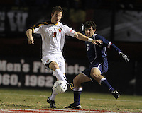 Jason Herrick #9 of the University of Maryland moves the ball away from Andres Casais #6 of Penn State during an NCAA 3rd. round match at Ludwig Field, University of Maryland, College Park, Maryland on November 28 2010.Maryland won 1-0.