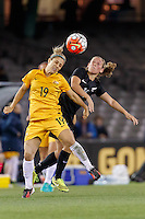 June 7, 2016: KATRINA GORRY (19) of Australia and ANNALIE LONGO (16) of New Zealand jump for the ball during an international friendly match between the Australian Matildas and the New Zealand Football Ferns as part of the teams' preparation for the Rio Olympic Games at Etihad Stadium, Melbourne. Photo Sydney Low
