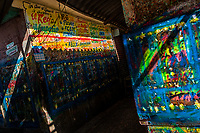 """Scribbled walls are seen in the sign painting workshop in Cartagena, Colombia, 16 April 2018. Hidden in the dark, narrow alleys of Bazurto market, a group of dozen young men gathered around José Corredor (""""Runner""""), the master painter, produce every day hundreds of hand-painted posters. Although the vast majority of the production is designed for a cheap visual promotion of popular Champeta music parties, held every weekend around the city, Runner and his apprentices also create other graphic design artworks, based on brush lettering technique. Using simple brushes and bright paints, the artisanal workshop keeps the traditional sign painting art alive."""