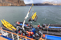 "Unloading Zodaics and sea kayaks from the ""Sea Spirit"" in Whalers Bay at Deception Island near the Antarctic Peninsula."