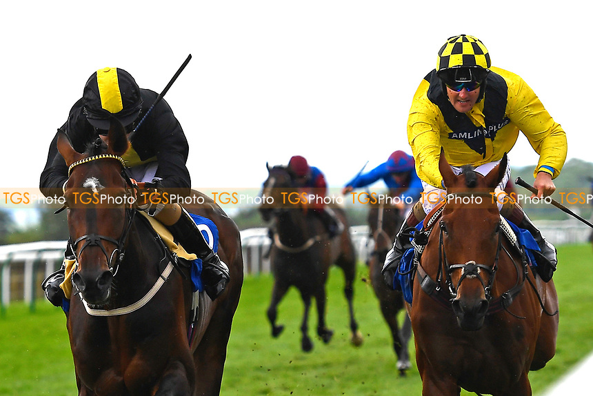 Winner of The H S Lester Memorial Handicap, Swashbuckle (l) ridden by Joshua Bryan and trained by Andrew Balding during Whitsbury Manor Stud Bibury Cup Day Racing at Salisbury Racecourse on 28th June 2017