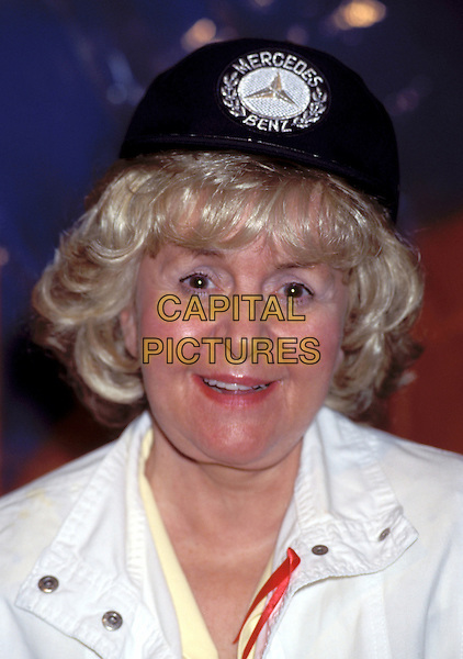 LYNNE PERRIE.LYNNE PERRY .baseball cap, aids awareness ribbon.Ref: 844.www.capitalpictures.com.sales@capitalpictures.com.© Capital Pictures