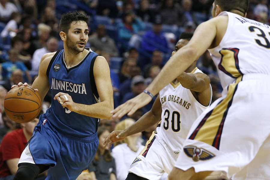 Minnesota Timberwolves guard Ricky Rubio (9) drives against New Orleans Pelicans forward Ryan Anderson (33) during the second half of an NBA basketball game Saturday, Feb. 27, 2016, in New Orleans. The Timberwolves won 112-110. (AP Photo/Jonathan Bachman)
