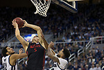 San Diego State forward Yanni Wetzell (5) shoots over the Nevada defense during the second half of a basketball game played at Lawlor Events Center in Reno, Nev., Saturday, Feb. 29, 2020. (AP Photo/Tom R. Smedes)