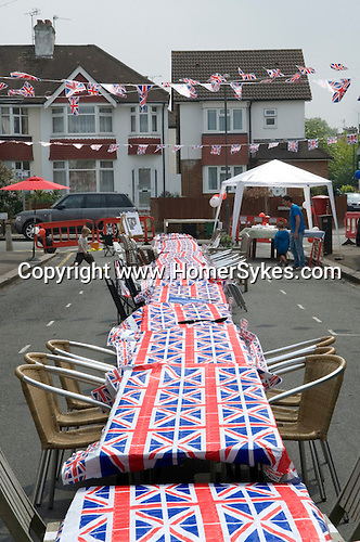 Getting ready for a Royal Wedding Street party. London 2011.