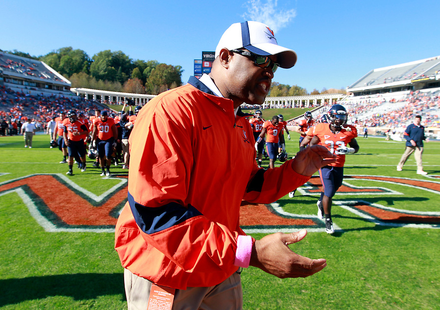 Oct. 15, 2011-Charlottesville, VA.-USA- Virginia Cavaliers head coach Mike London pumps up his players before the start of an ACC football game against Georgia Tech at Scott Stadium. Virginia won 24-21. (Credit Image: © Andrew Shurtleff