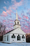 The 1794 Meetinghouse in New Salem with colorful early morning clouds.