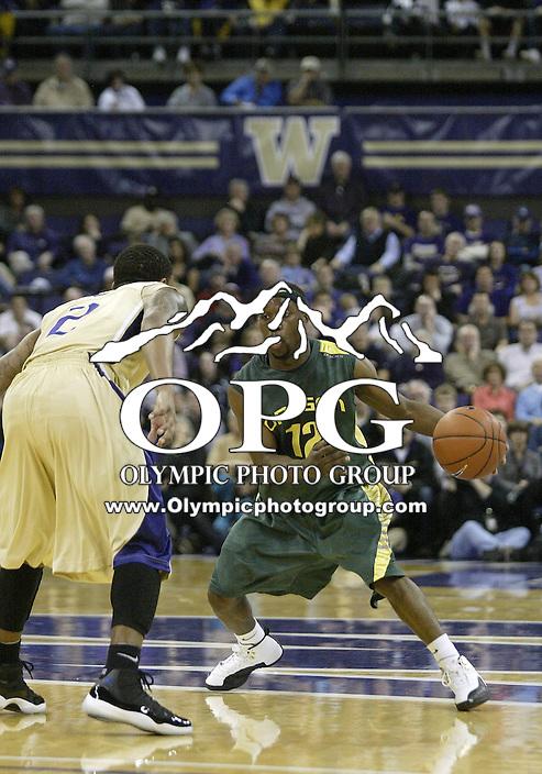 02 January 2010:  Oregon guard #12 Tajuan Porter drives to the basket against Washington. Oregon won 90-79 over  Washington at the Bank of America Arena in Seattle, WA.