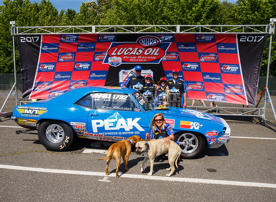 Jun 11, 2017; Englishtown , NJ, USA; Super Stock winner Timothy Fletcher celebrates in the winners circle with his family and dogs after winning the Summer Nationals at Old Bridge Township Raceway Park. Mandatory Credit: Mark J. Rebilas-USA TODAY Sports